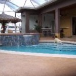 Pool deck is a concrete overlay, with stamped slate coping,